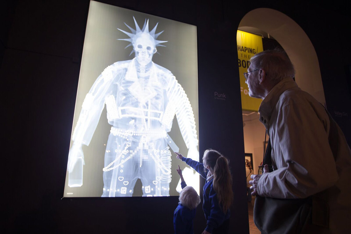 Young and old alike learning from a human X-ray on a lightbox display