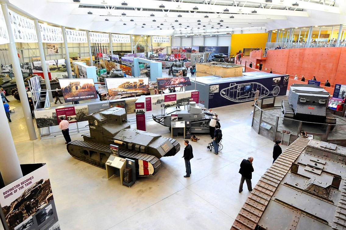 A range of military tanks and mechanised vehicles with exhibition information boards