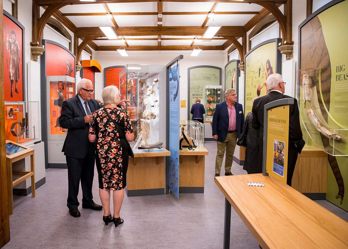 Visitors exploring the Norris Museum's exhibition space