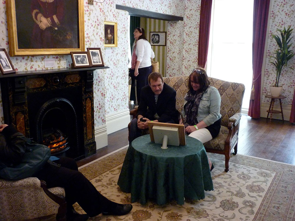 Visitors sit and view informative video at Prittlewell Priory as part of an enhanced experience